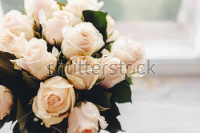 Fototapeta White roses bouquet on wooden background in light, space for text. Floral greeting card mockup. Wedding invitation,happy mother day or Valentine day concept. Tender Flowers