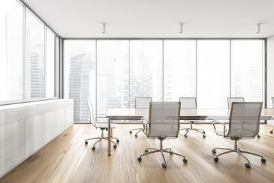Fototapeta White wooden office meeting room with table and armchairs near big window