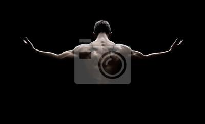 Fototapeta Widok z tyłu zdrowego młodego człowieka z wyciągniętymi rękami