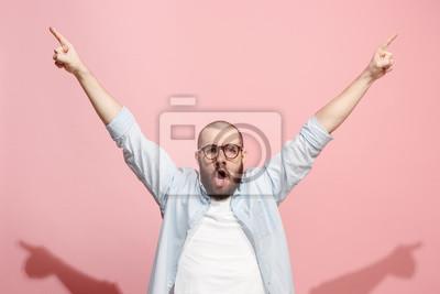 Fototapeta Winning success man happy ecstatic celebrating being a winner. Dynamic energetic image of male model