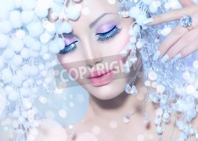 Fototapeta Winter Woman  Beautiful Fashion Model with Snow Hairstyle
