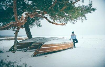 Woman alone in winter landscape