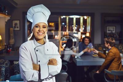Fototapeta Woman chef in a restaurant.