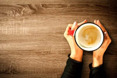 Woman hands with cup of coffee and free space for your decoration.
