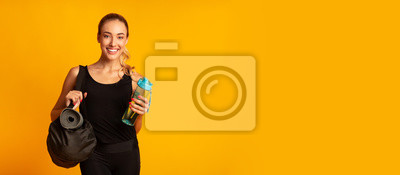 Fototapeta Woman Holding Fitness Bag Ready For Training, Studio Shot, Panorama
