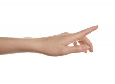 Fototapeta Woman pointing at something on white background, closeup