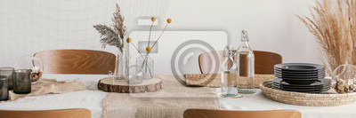 Fototapeta Wooden slices and linen napkins on the table