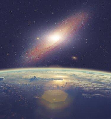 Fototapeta Wschód słońca nad Ziemi z wielką Galaktyka Andromedy.