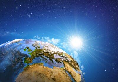 Fototapeta Wschód słońca nad Ziemią