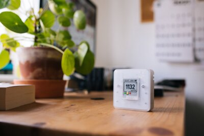 Fototapeta CO₂ sensor monitor. Indoor air quality sensor. Healthy work environment. Work from home. Control proper ventilation in your levels airflow in the room. Carbon dioxide levels and airflow. Smart home