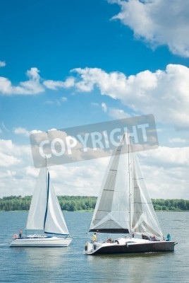 Fototapeta  yachts on an anchor in harbor, boats series