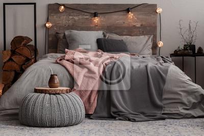 Fototapeta Yerba matte on wooden plate on grey woolen pouf in stylish bedroom interior