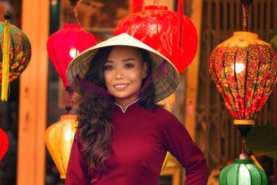 Fototapeta Young asian woman in traditional vietnamese dress ao dai