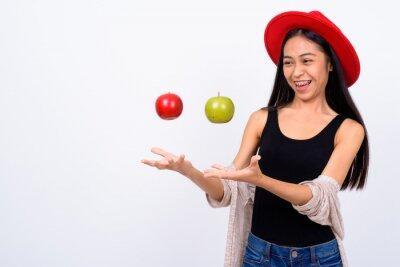 Fototapeta Young beautiful Asian woman against white background