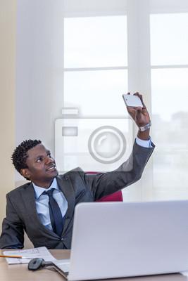 Young black man taking self portrait