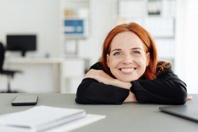 Fototapeta Young businesswoman sitting daydreaming