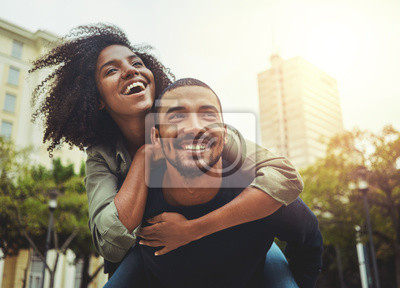 Fototapeta Young couple in love having fun in the city