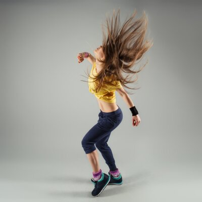 Fototapeta Young energetic zumba fitness woman dancer moving in class