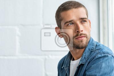 Fototapeta Young pensive man looking away
