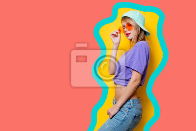 Fototapeta Young style girl with sunglasses on drawn living coral color background.
