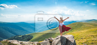 Fototapeta Young woman on the top of mountain