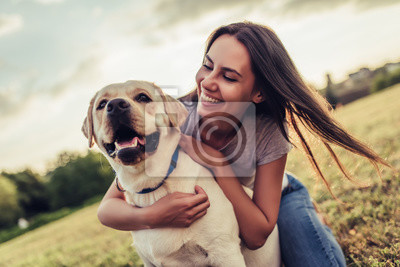 Fototapeta Young woman with dog