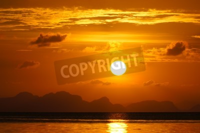 Fototapeta zachód słońca na niebie