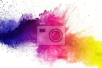Fototapeta Zamrozić ruch kolorowych eksplozji w proszku na białym tle.