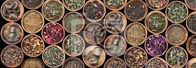 Fototapeta Zestaw różnych herbat spodek na czarnym tle