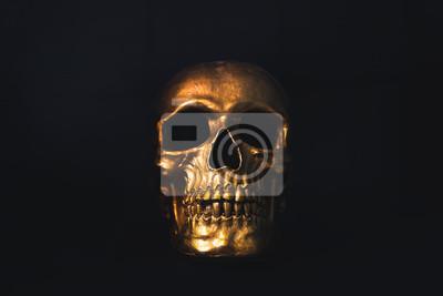 Fototapeta Złota czaszka na czarnym tle