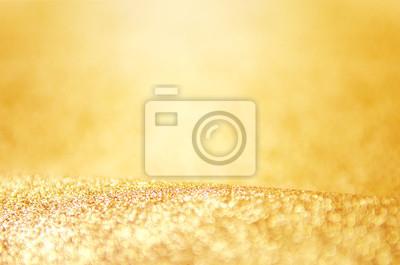 Fototapeta Złoty glitter, defocused streszczenie świąt światła na tle. nowy rok i Boże Narodzenie w tle.