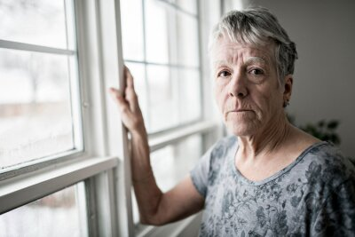 Naklejka A sad lonely 70 years old senior in is apartment