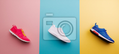 Naklejka A studio shot of running shoes on bright color background. Flat lay.