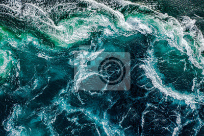 Naklejka Abstract background. Waves of water of the river and the sea meet each other during high tide and low tide. Whirlpools of the maelstrom of Saltstraumen, Nordland, Norway