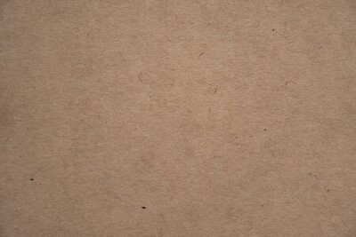 Naklejka Abstract brown recycled paper texture background or backdrop. Empty old cardboard or recycling paperboard for design element. Simple beige grainy surface for journal template presentation.
