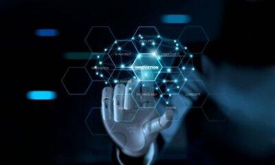 Naklejka Abstract futuristic, Businessman mechanical robotic arm touching word innovation and brain on virtual screen interface. AI, futuristic technology concept.