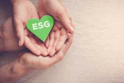 Naklejka Adult and child hands holding green heart with ESG, Environmental, social and corporate governance concept