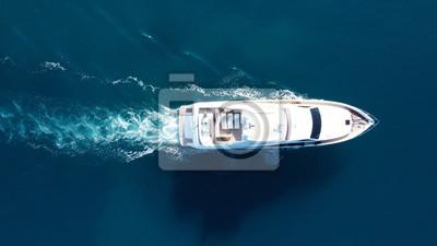 Naklejka Aerial drone photo of luxury yacht cruise in mediterranean deep blue sea