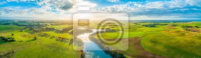 Naklejka Aerial panoramic landscape of scenic sunset over river and grasslands in Australia