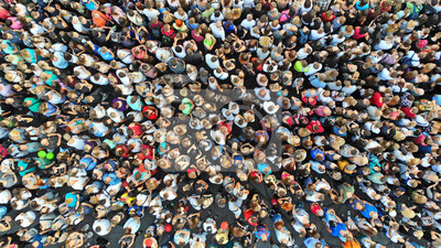 Naklejka Aerial. People crowd background. Mass gathering of many people in one place. Top view.