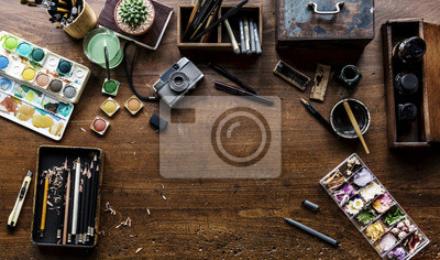 Naklejka Aerial view of artistic euqipments painting tools on wooden table