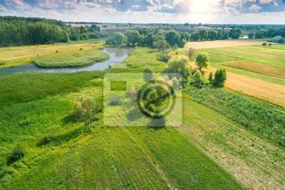 Aerial view of countryside and brook on a spring sunny day. Beautiful nature landscape in spring