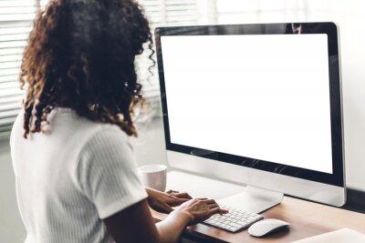 Naklejka African american black woman using computer with white mockup blank screens in modern work loft