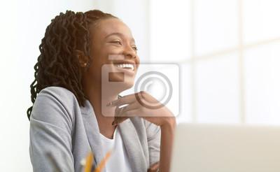 Naklejka Afro Businesswoman Laughing Sitting In Front Of Window Indoor
