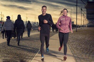 Naklejka Aktives junges Paar beim Jogging