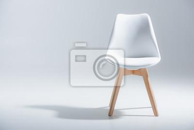 Naklejka Album nagrywany stylowe krzesło z białego góry i lekkie drewniane nogi stały na białym tle
