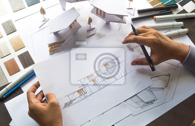 Naklejka architect design working drawing sketch plans blueprints and making architectural construction model in architect studio