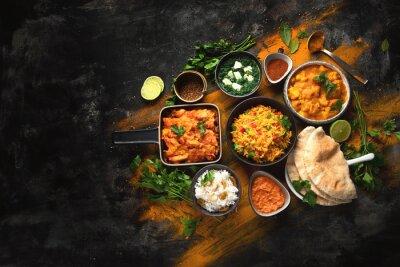 Naklejka Assorted indian food on black background..