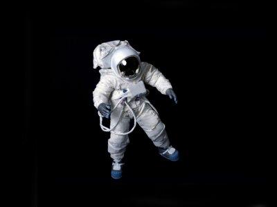 Naklejka Astronauta pływających na czarnym tle.