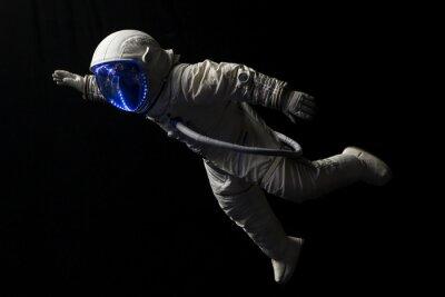 Naklejka Astronauta w misji kosmicznej, w ciemności i przestrzeni